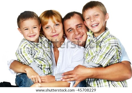father, mother and their two sons - stock photo