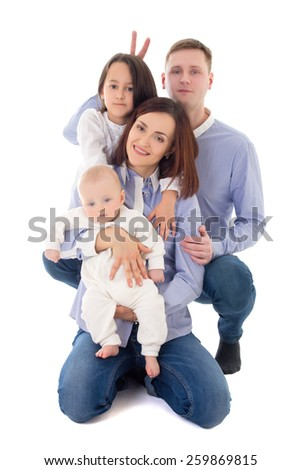 father, mother, daughter and son sitting isolated on white background - stock photo