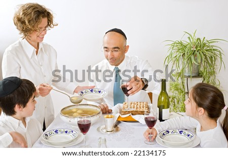 father mother son and daughter in seder celebrating passover