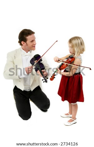 Father or teacher and five year old daughter in formal wear with violins