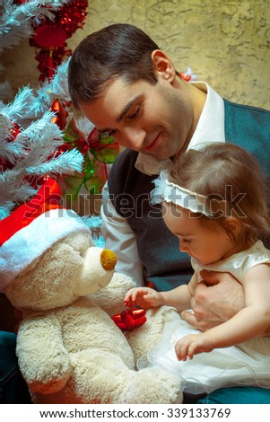 Father play with his little baby girl at christmas time. Christmas mood. New year. - stock photo