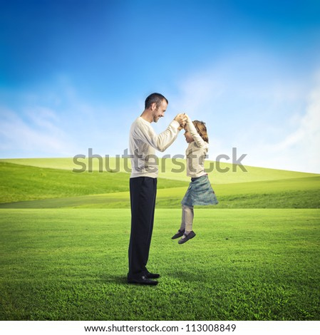 Father playing with her daughter - stock photo