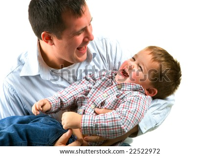 Father playing with his little boy. - stock photo