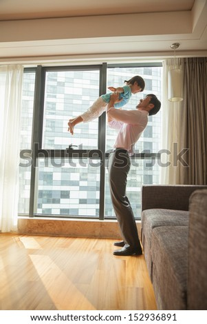 Father playing with his son - stock photo