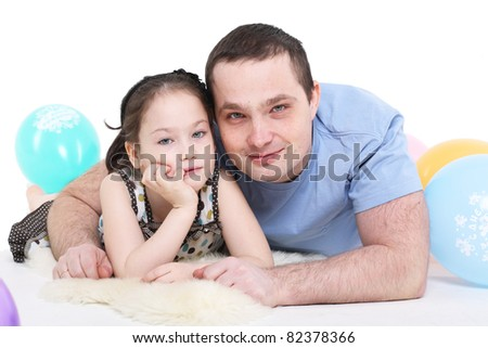 father plays with the daughter. It is isolated on a white background.