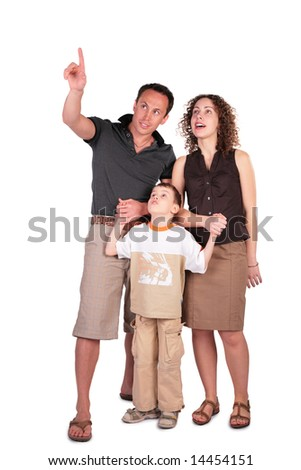 father pointed something at  top of mother and  son - stock photo