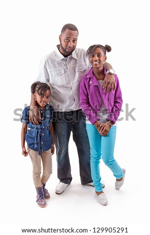 father posing with two daughters on white background
