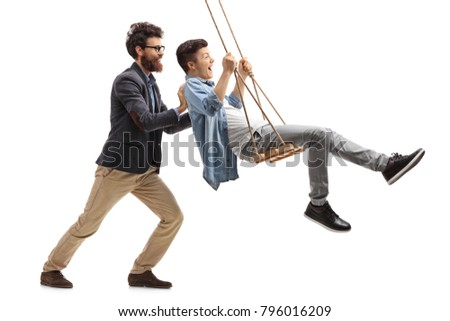 Father pushing his teenage son on a wooden swing isolated on white background
