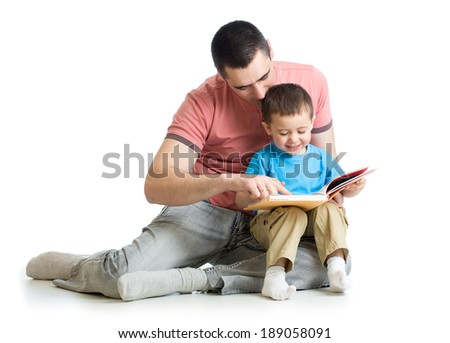 father reading a book to kid - stock photo