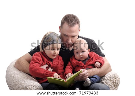 father reading a story at his two little daughters. isolated on white - stock photo