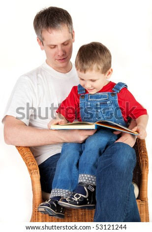 Father reading book her son - stock photo