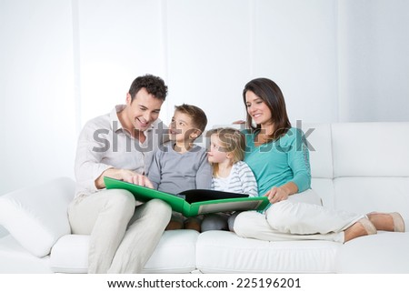 father reads a story to his children - stock photo