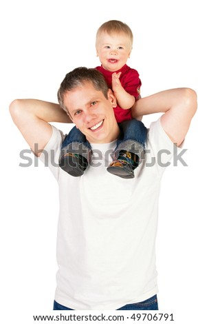 Father riding his son piggyback - stock photo