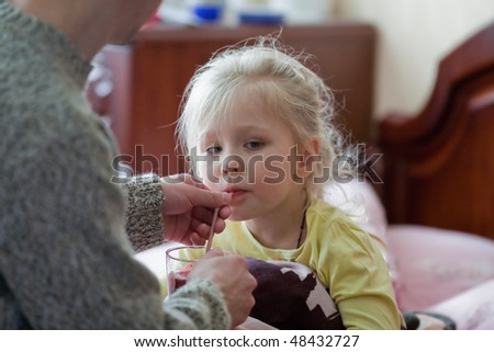 Father's daughter gives to drink before bedtime