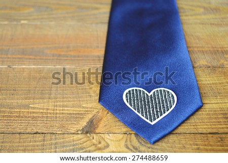 Father's Day gift: a blue tie on wooden background - stock photo