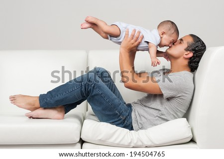 Father's day series: Father and little baby boy - stock photo