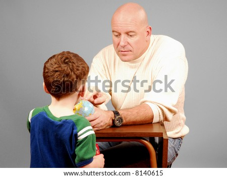 Father Showing Son a Globe - stock photo