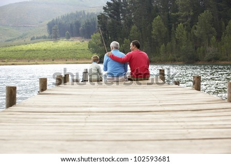 Father,son and grandfather fishing - stock photo
