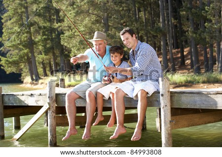 Father,son and grandson fishing together - stock photo