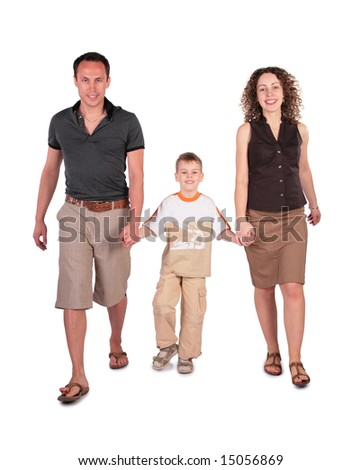 father, son and mother go having joined hands - stock photo
