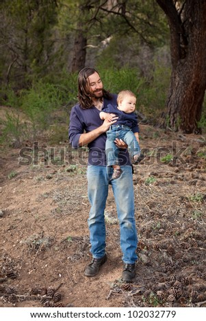 Father & son having a day of fun in the nature. Shallow DOF, focus on man's face - stock photo