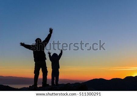 Father son peak sunrise success