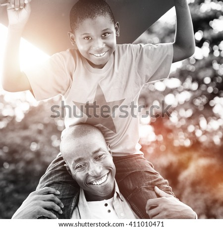 Father Son Playing Kite Summer Fun Concept - stock photo