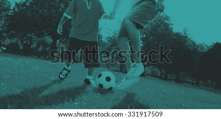 Father Son Playing Soccer Park Summer Concept - stock photo