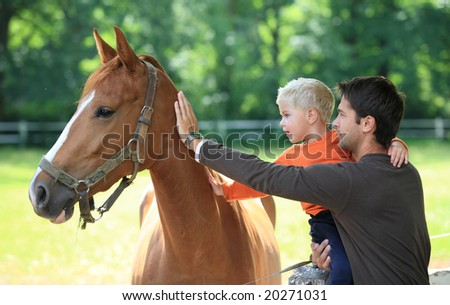 father soon horse relax - stock photo