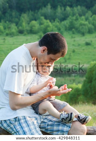 Father spends time with his son. Child education - stock photo