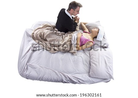 father taking care of his sick teenage daughter - stock photo