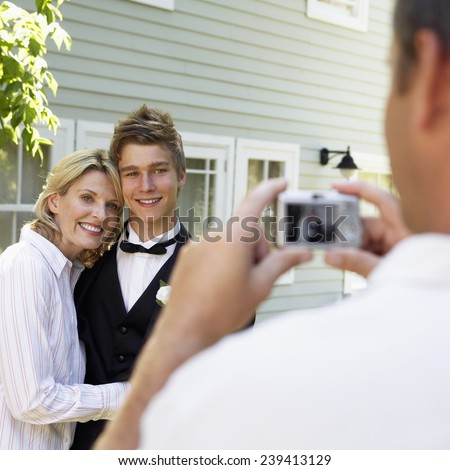 Father Taking Picture of Wife and Son - stock photo