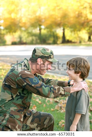 Father Talking to Son - stock photo