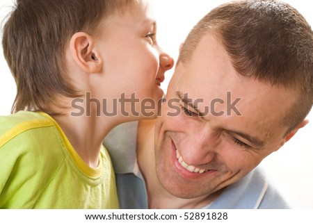 father talking with his son on a white background - stock photo