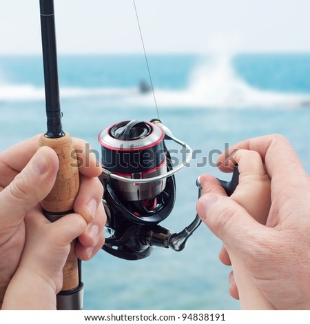 Father teaching his child to fishing on. Fishing family day (Discipleship concept) - stock photo