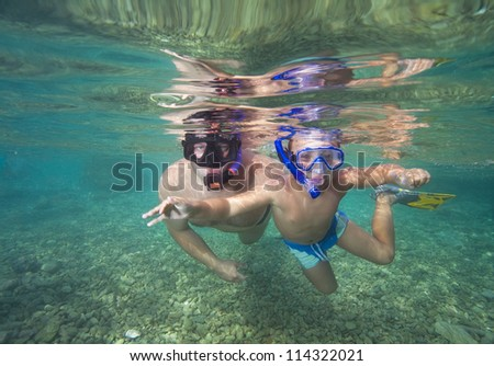 Father teaching his little son it dive