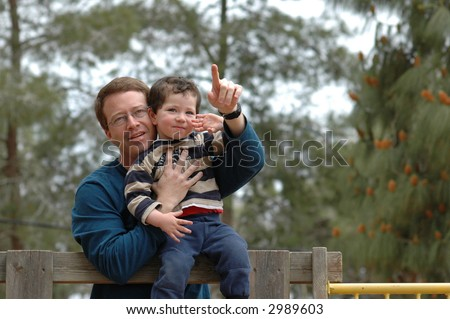 Father teaching son - stock photo