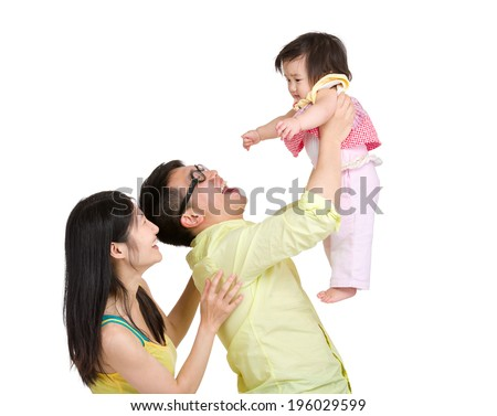Father throwing little daughter in air - stock photo