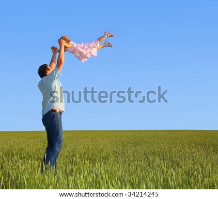Father throws the daughter - stock photo