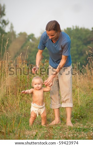 father walk with baby girl in park