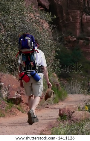 Father with baby in backpack