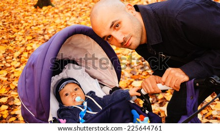 Father with baby in buggy - stock photo
