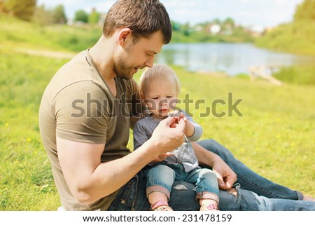 Father with baby together resting in summer day - stock photo