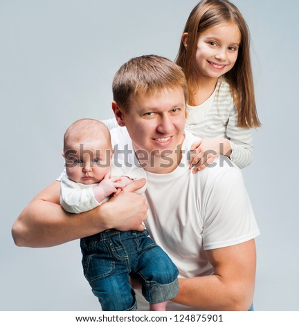 Father with beautiful baby and little daughter - stock photo