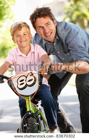 Father with boy on bike - stock photo