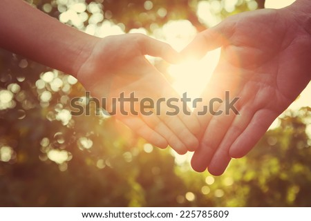 Father with child holding hands.  Instagram effect. - stock photo