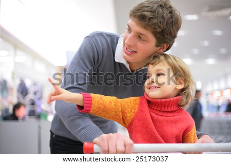 Father with child  in shop - stock photo