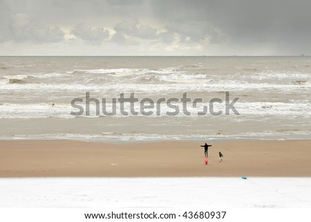 Father with children on a snowy beach