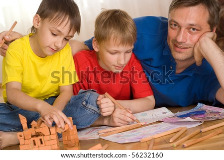 Father with children playing on the floor