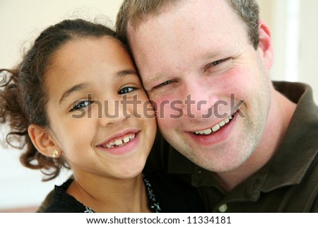 Father with Daughter smiling - stock photo